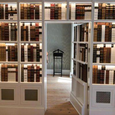 Lit faux bookcase secret door open