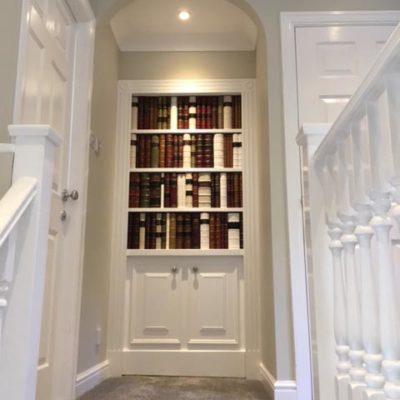 Secret bookcase door private client